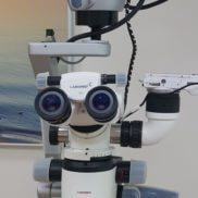 Dental treatment with a microscope